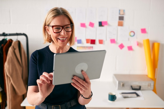 woman business owner looking at tablet