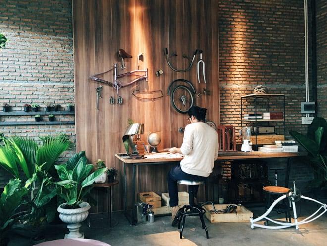 custom bicycle entrepreneur in his workshop