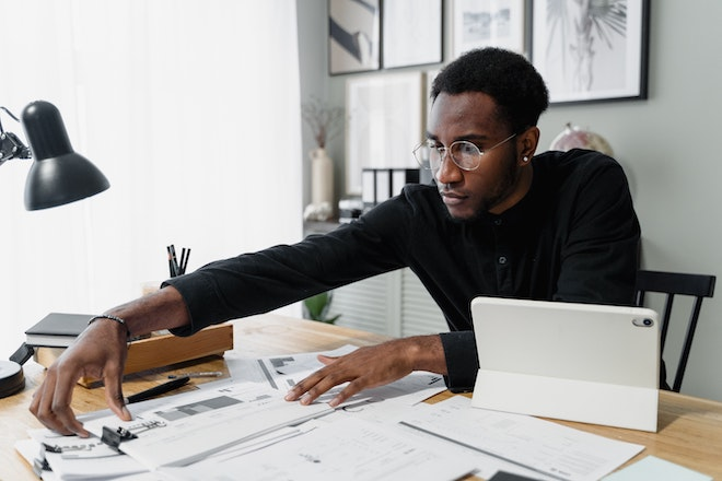 accountant working at desk with paperwork