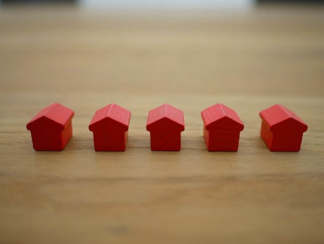red miniature houses on a table