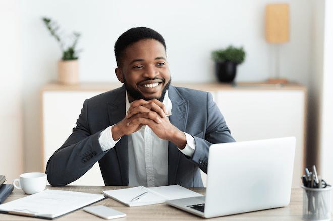 smiling businessman with pllc vs. llc paperwork