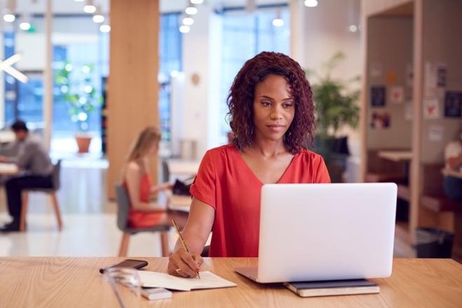 Businesswoman at desk in modern workspace