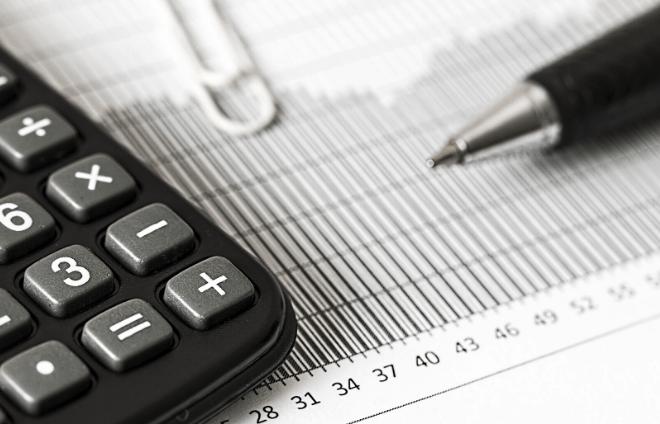 Calculator, pen, and paperwork