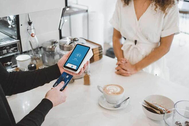 customer paying for coffee with business credit card