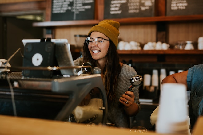barista working at coffee shop