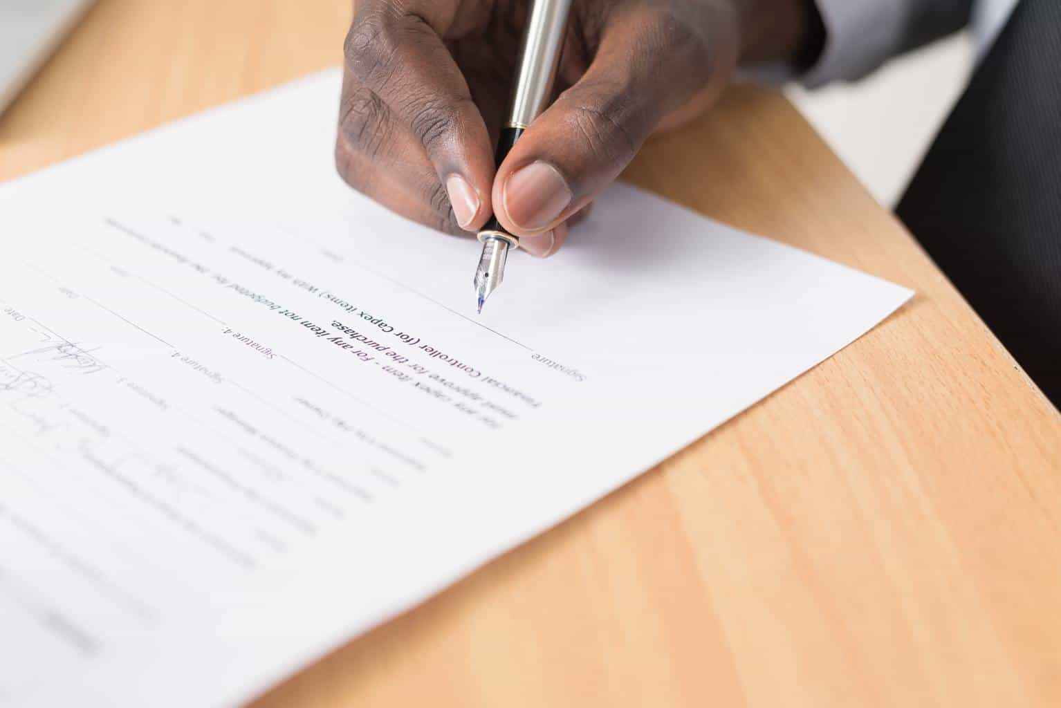 hand signing an official form