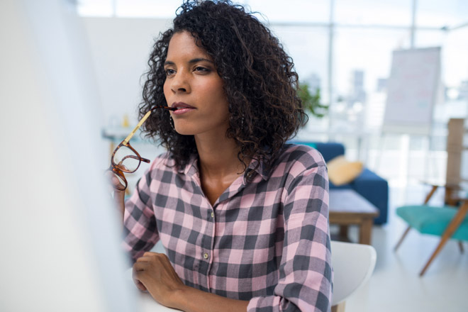 Female executive working on computer at desk in the office