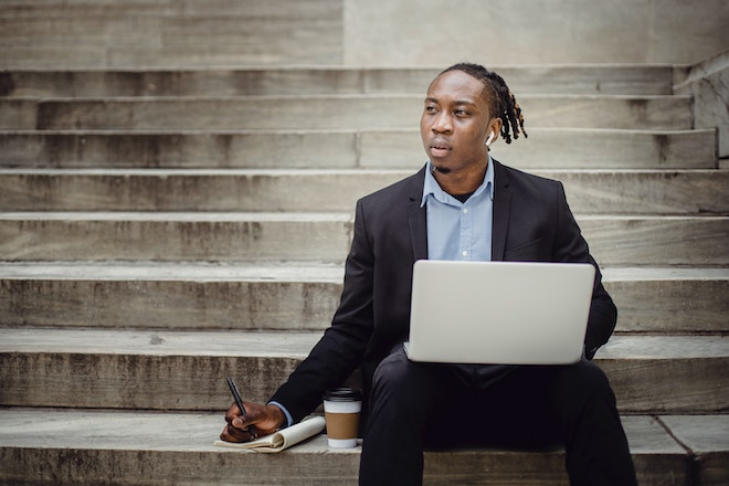 businessman working on steps with laptop
