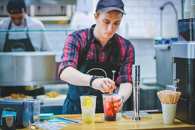 employee working at drink bar