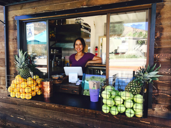 small business owner working at local juice bar