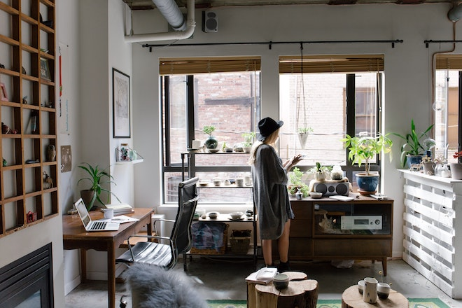 woman working at home standing with tablet