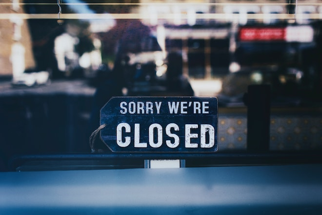 close up photo of closed sign in window