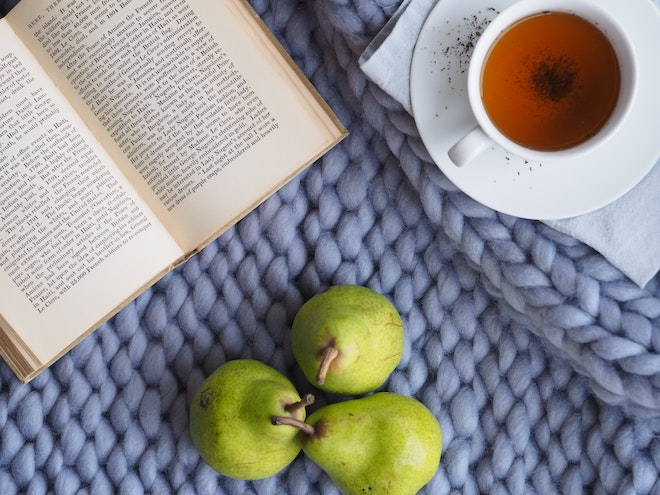 self care scene with pears, tea, and a book