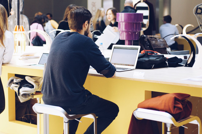 man working at coworking business space