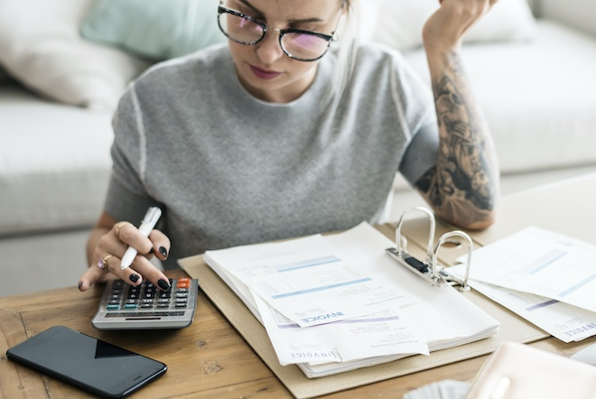 woman working on taxes