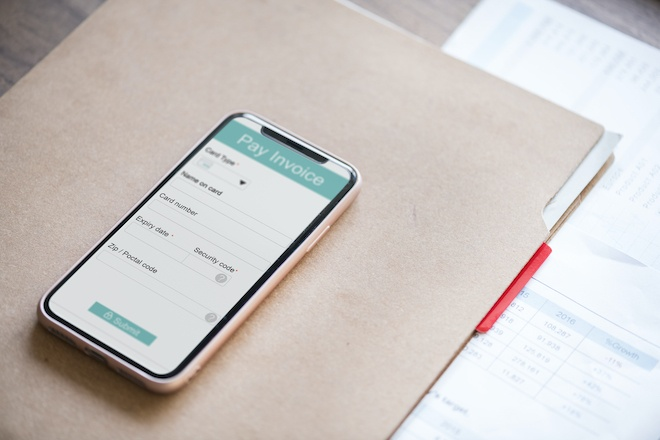 online banking paying invoice on smartphone