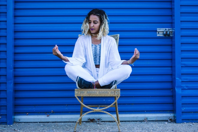 woman meditating in a chair