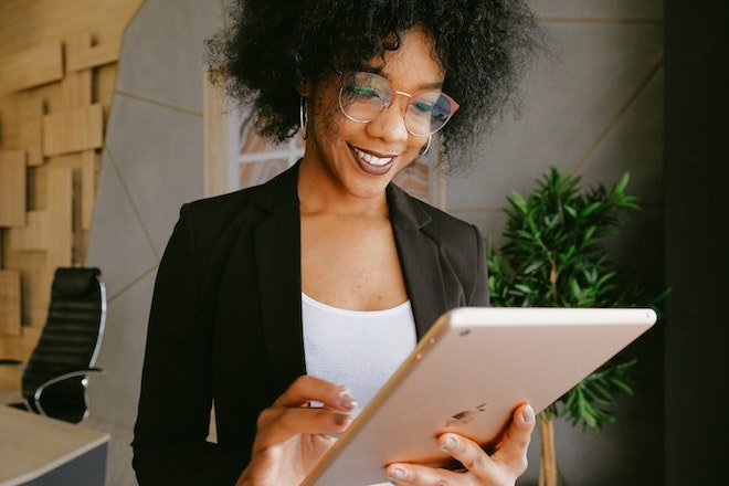 woman business owner with tablet