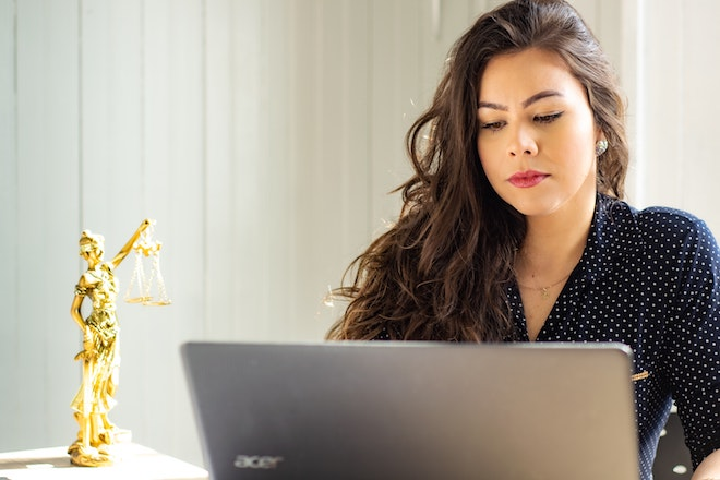 woman working at laptop on desk
