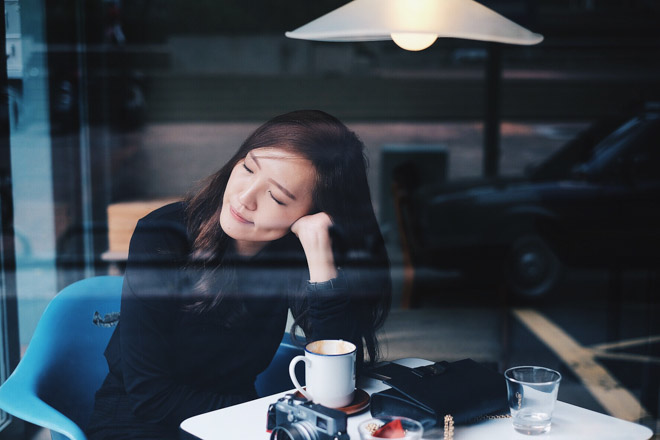 woman resting at a desk