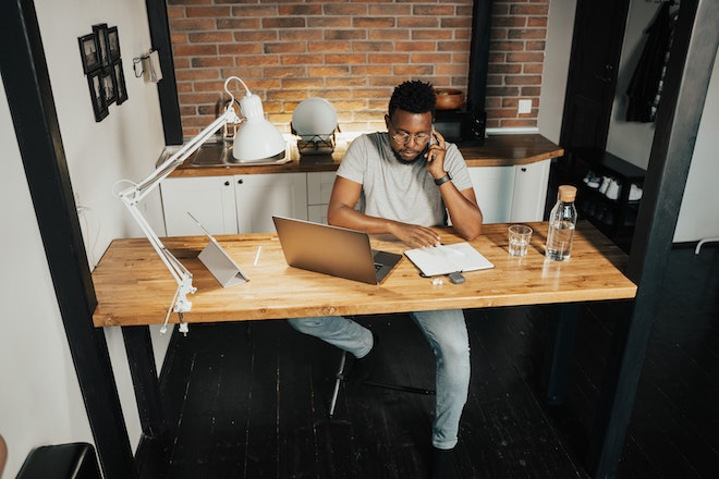 man working remotely from home desk