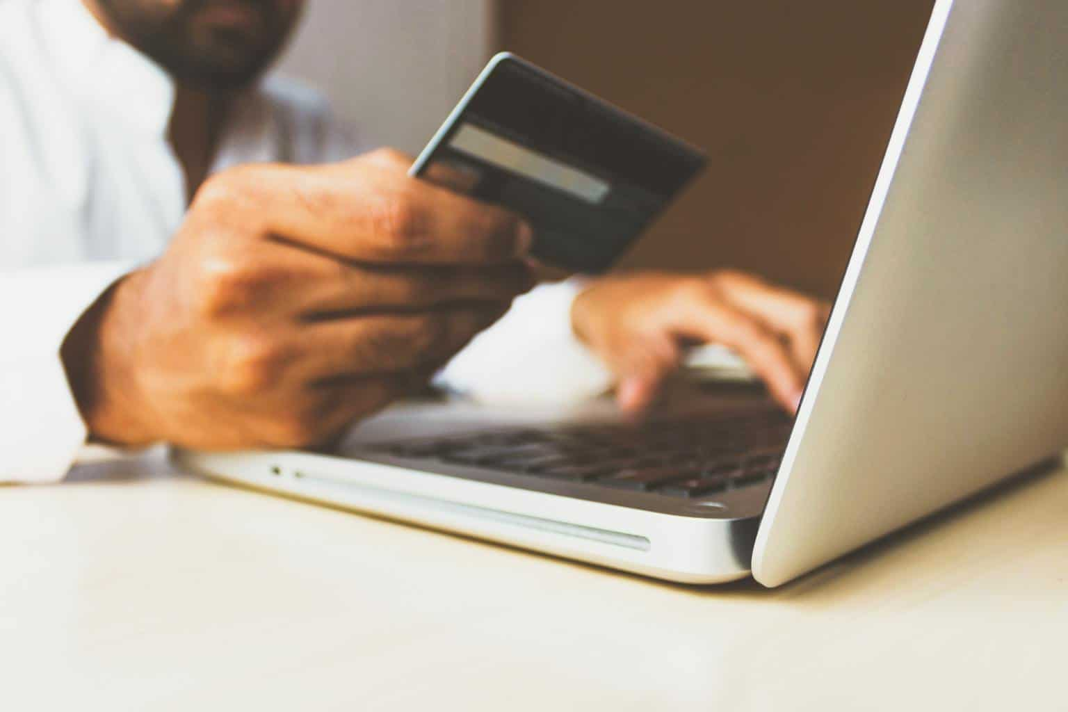 person using a business credit card to buy something online