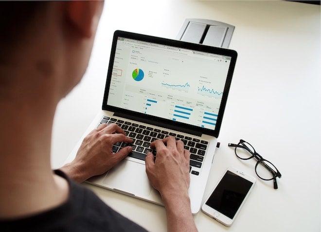 person using MacBook pro computer