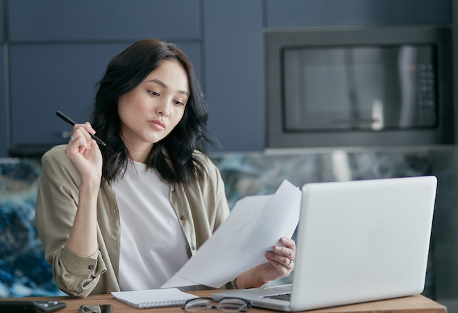 woman looking at tax paperwork