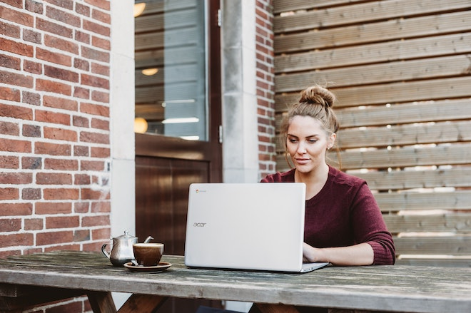 woman working outdoors on laptop