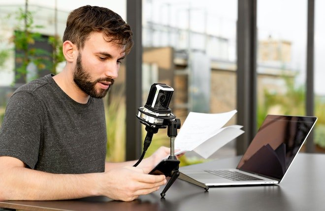 man working on podcast