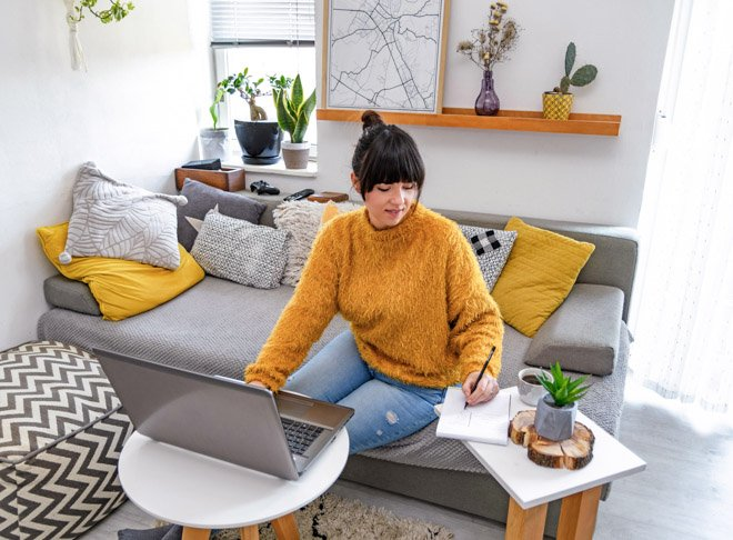 woman working on her foreign qualification on laptop at home